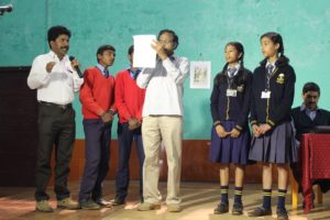 Mr Ramu leading students in taking the pledge to cast their vote