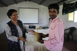 Anita presenting the YELP certificate to Vishu
