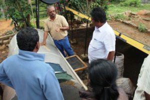 Leo explaining the functioning of the solar tunnel dryer at Banglapadiga