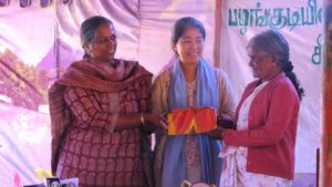 Sneh and Femy presenting Janakiamma with the PKF award plaque